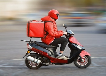 Food delivery courier in red outfit