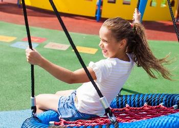 Girl on spiderweb swing