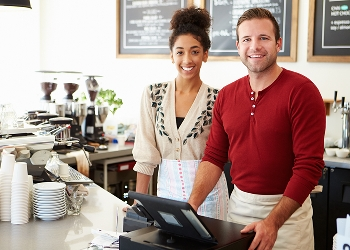 Woman and man standing at cafe counter