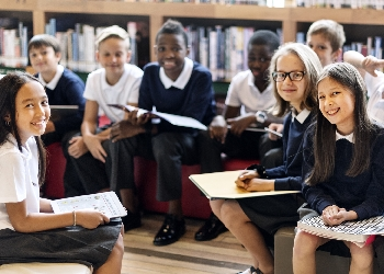School students sitting in library