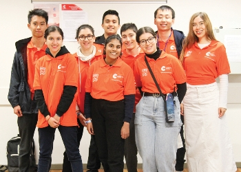Group of young people wearing orange tshirts participating in Youth Week 2021